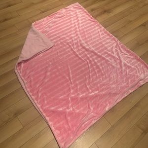 Soft pink and striped blanket